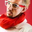 Man with red scarf against coloured background — Stock Photo #4444799