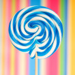 Stock Photo: Colourful lollipop against colourful background