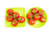 Red tomatoes isolated on the white background — Stock Photo