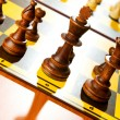 Set of chess figures on the playing board - Стоковая фотография