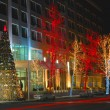 Christmas tree and trees decorated with lights in Baku, Azerbaijan - Stock Photo