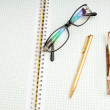 Pen and eye glasses on the page — Stock Photo #4457854