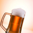 Beer glasses against the colorful gradient background - 图库照片