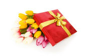 Giftbox and flowers isolated on the white background — Stock Photo