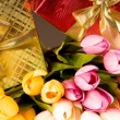 Celebration concept - gift box and tulip flowers — Stock Photo #4464023