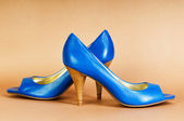 Fashion concept with blue woman shoes on high heels — Stock Photo