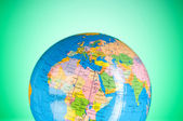 Globalisation concept - globe against gradient colorful backgrou — Stock Photo