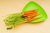 Fresh carrots on the wooden table — Stock Photo