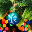 Christmas decoration and blurred lights at background — Stock Photo #4498856
