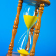 Time concept - hourglass against the gradient background — Stock Photo #4499426