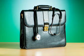 Doctor's case with stethoscope against colorful background — Stock Photo
