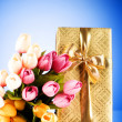 Celebration concept - gift box and tulip flowers — ストック写真