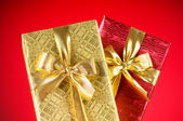 Celebration concept - Gift box against colorful background — Stock Photo