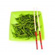 Hot peppers with chopsticks and plate - Stok fotoğraf