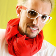 Man with red scarf against coloured background — Stock Photo #4511109
