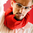 Royalty-Free Stock Photo: Man with red scarf against coloured background