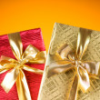 Celebration concept - Gift box against colorful background - Foto Stock