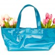 Bag and flowers isolated on the white background — Stock Photo