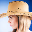 Young girl wearing cowboy hat in the studio — Stock Photo #4517381