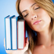 Young university student with many study textbooks — Stock Photo #4517450