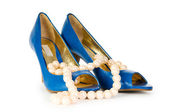 Woman shoes and necklace isolated on the white background — Stock Photo