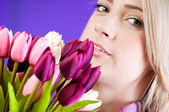 Blond girl with flowers — Stock Photo