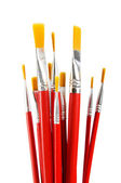 Red art brushes isolated on the white background — Stock Photo