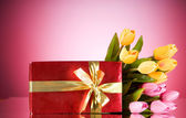 Celebration concept - gift box and tulip flowers — Stockfoto