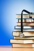 Books and stethoscope against the gradient background — Stok fotoğraf