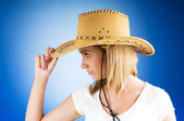 Young girl wearing cowboy hat in the studio — Stock Photo