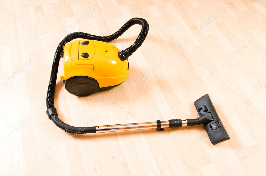 Vacuum cleaner on the polished wooden floor  — Stock Photo #4517180