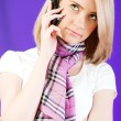 Stock Photo: Blond girl talking on mobile phone