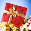 Celebration concept - gift box and tulip flowers — Stock Photo #4524898