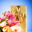 Celebration concept - gift box and tulip flowers — Stok fotoğraf