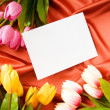 Envelope and flowers on the satin background — Stock Photo #4529660