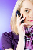Attractive girl speaking on the mobile phone — Stock Photo