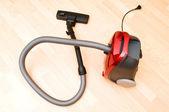 Vacuum cleaner on the wooden floor — Stock Photo