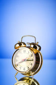 Time concept - alarm clock against colorful background — Stock Photo