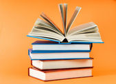 Stack of books on the color background — Stock Photo