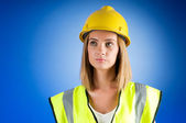 Young girl with hard hat against background — Stock Photo