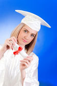 Happy graduate against colourful background — Stock Photo