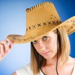 Stock Photo: Young girl wearing cowboy hat in studio
