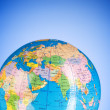 Stock Photo: Globalisation concept - globe against gradient colorful backgrou
