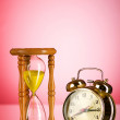 Stock Photo: Time concept with clock and hour glass