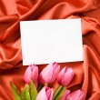 Envelope and flowers on the satin background — Stock Photo #4534892