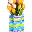 Tulips in shopping bag isolated on white — Stock Photo
