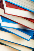 Stack of text books against gradient background — Stock Photo