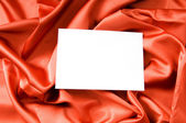 Blank message on the red satin background — Stock Photo