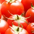 Stock Photo: Red tomatoes arranged at market stand