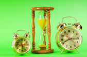 Time concept with clock and hour glass — Stock Photo